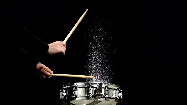hd super slow-mo: drummer splashing water off the drum - drum percussion instrument stock videos & royalty-free footage