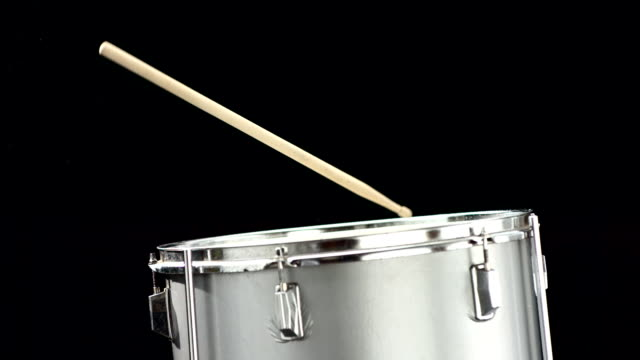 hd super slow-mo: drum-stick falling on a drum - drum percussion instrument stock videos & royalty-free footage