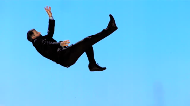 hd super slow-mo: executive falling down - falling stock videos and b-roll footage