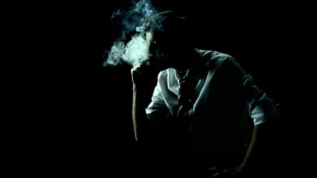 hd super slow-mo: executive smoking in the dark - cigar stock videos & royalty-free footage