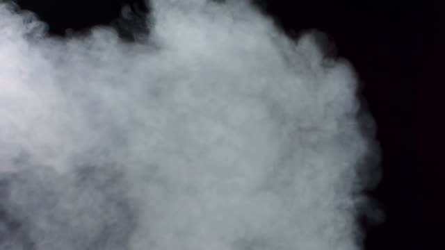 HD Super Slow-Mo: Exhaust Fume Over Black Background