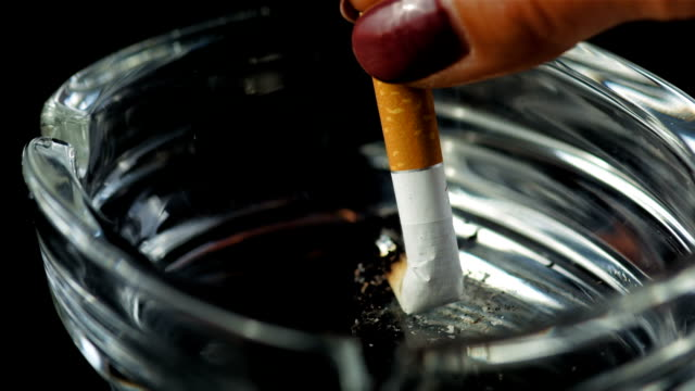 hd super slow-mo: extinguishing a cigarette - cigarette stock videos & royalty-free footage