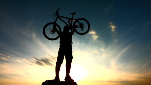 HD Super Slow-Mo: Extreme Biker Holding His Bike