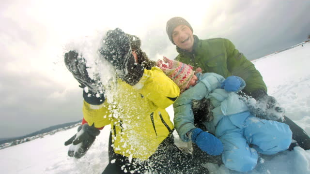 hd super slow-mo: family playfully throwing snow - ski holiday stock videos & royalty-free footage