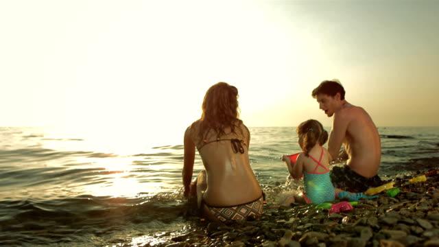HD Super Slow-Mo: Family Splashing Water On The Beach