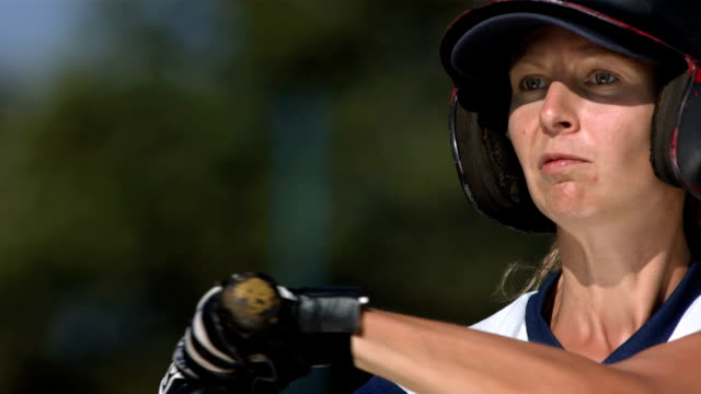 HD Super Slow-Mo: Female Baseball Batter In Action