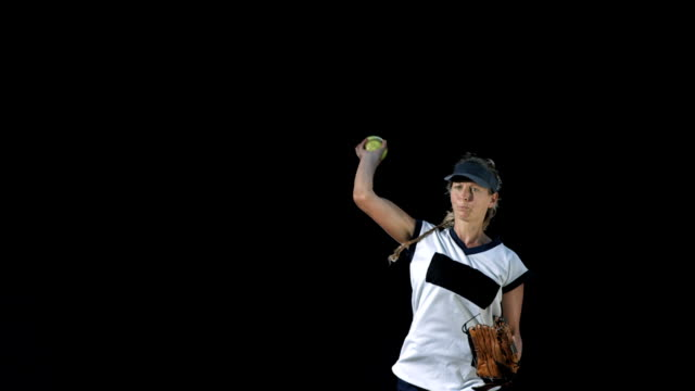 hd super slow-mo: female player pitching a softball - pitch stock videos & royalty-free footage