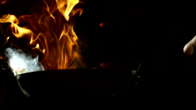 hd super slow-mo: flambeing vegetables - flame stock videos & royalty-free footage