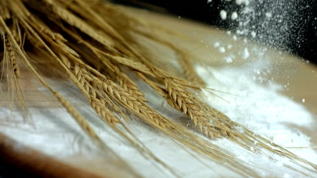 hd super slow-mo: flour falling on wheat - wholegrain stock videos & royalty-free footage
