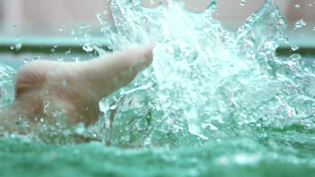 HD Super Slow-Mo: Footstep Children practice swimming