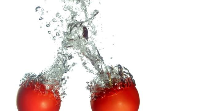 HD Super Slow-Mo: Fresh Tomatoes Splashing Into Water