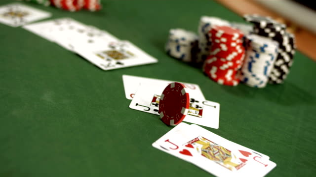 stockvideo's en b-roll-footage met hd super slow-mo: gambling chip spinning on a table - casino
