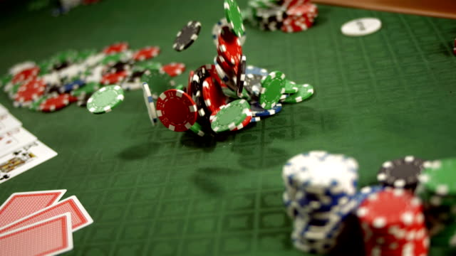 hd super slow-mo: gambling chips falling on a table - gambling chip stock videos and b-roll footage