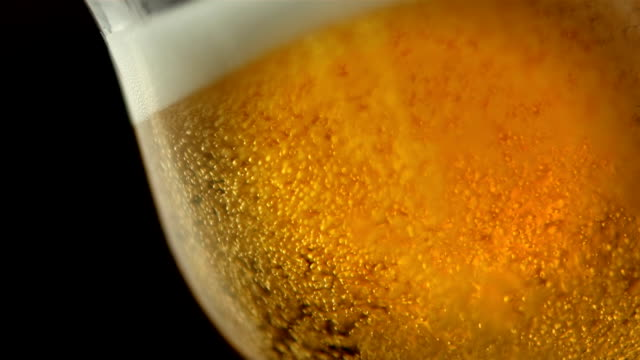 hd super slow-mo: glass of beer - drinking beer stock videos and b-roll footage