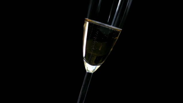 HD Super Slow-Mo: Glass Of Champagne Bubbles