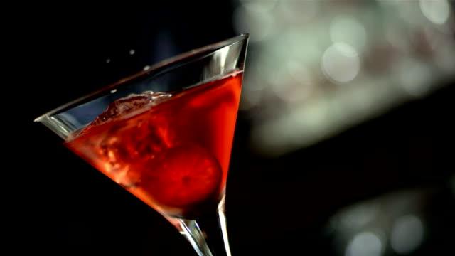 hd super slow-mo: glass of cosmopolitan - garnish stock videos & royalty-free footage