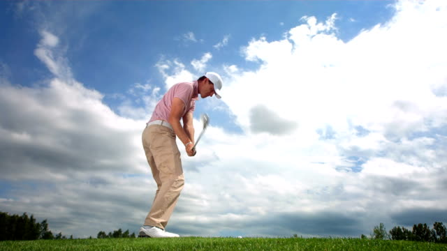 hd super slow-mo: golfer taking an iron shots - teeing off stock videos & royalty-free footage