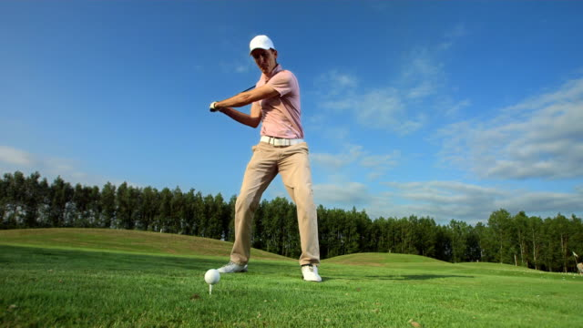 hd super slow-mo: golfer teeing off - golf club stock videos & royalty-free footage
