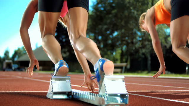 hd super slow-mo: group of runners starting off - athleticism stock videos & royalty-free footage