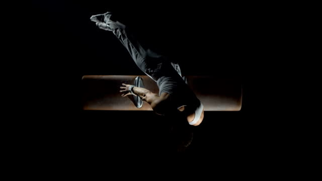 hd super slow-mo: gymnast swinging on pommel horse - spinning stock videos & royalty-free footage