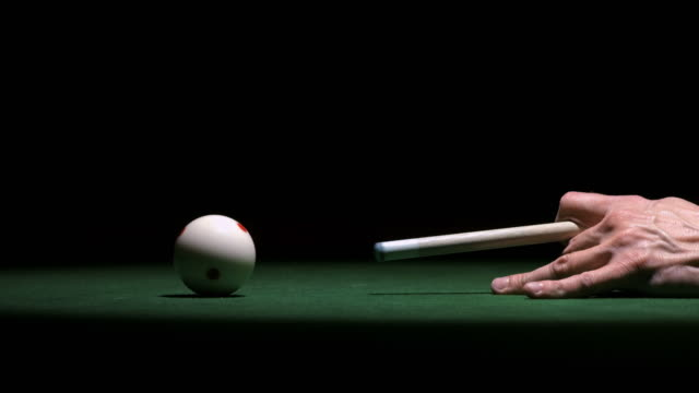 hd super slow-mo: hand shooting the cue ball - pool table stock videos & royalty-free footage