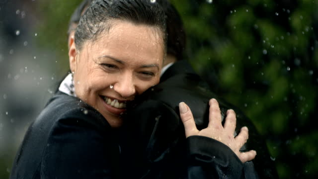 HD Super Slow-Mo: Happy Couple Embracing In The Rain