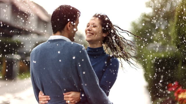 HD Super Slow-Mo: Happy Couple Spinning In The Rain