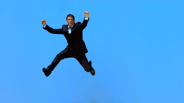 hd super slow-mo: happy executive punching the air - jumping stock videos & royalty-free footage