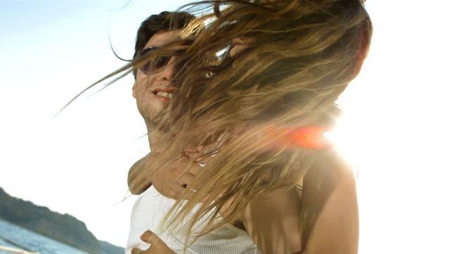 HD Super Slow-Mo: Happy Piggyback Couple On Honeymoon Vacation