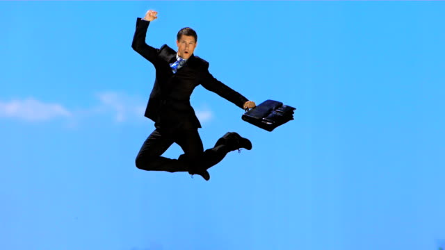 hd super slow-mo: happy yuppie jumping in the sky - yuppie stock videos and b-roll footage