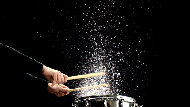 hd super slow-mo: hitting wet snare drum - drummer stock videos & royalty-free footage