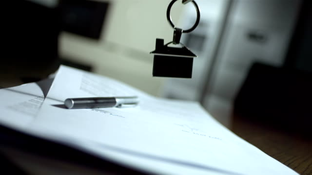 hd super slow-mo: house keys on a signed contract - document stock videos & royalty-free footage