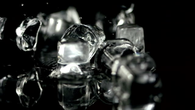 HD Super Slow-Mo: Ice Cubes On A Glass Surface