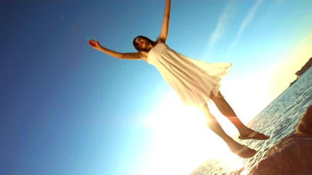 hd super slow-mo: joyful woman jumping on the beach - joy stock videos & royalty-free footage
