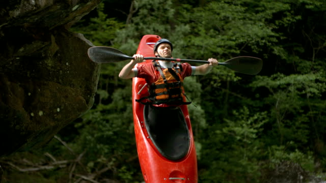hd super slow-mo: kayaker jumping off the rock - kayak stock videos & royalty-free footage