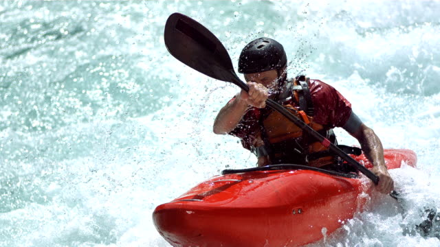hd super slow-mo: kayaker running a class iii rapid - rapid stock videos & royalty-free footage