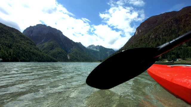 hd super slow-mo: kayaker splashing water with oar - oar stock videos & royalty-free footage
