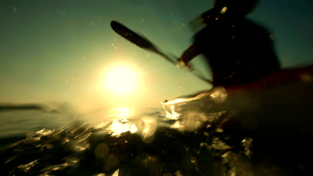 hd super slow-mo: kayaking in the sea at sunset - canoeing stock videos and b-roll footage