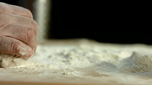 hd super slow-mo: kneading yeast dough - bakery stock videos and b-roll footage