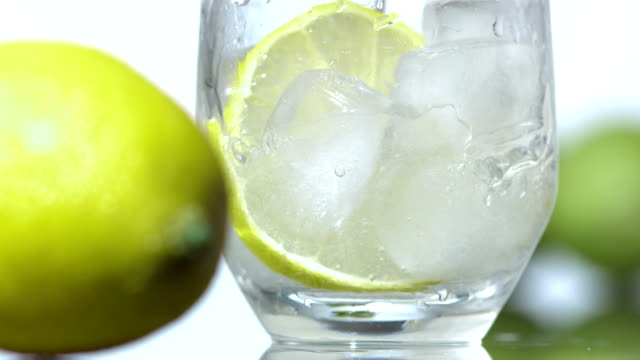hd super slow-mo: lime alcohol beverage - chopped food stock videos and b-roll footage
