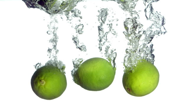 HD Super Slow-Mo: Limes Splashing Into Water