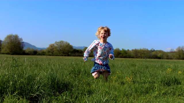 HD Super Slow-Mo: Little Girl Running In The Meadow