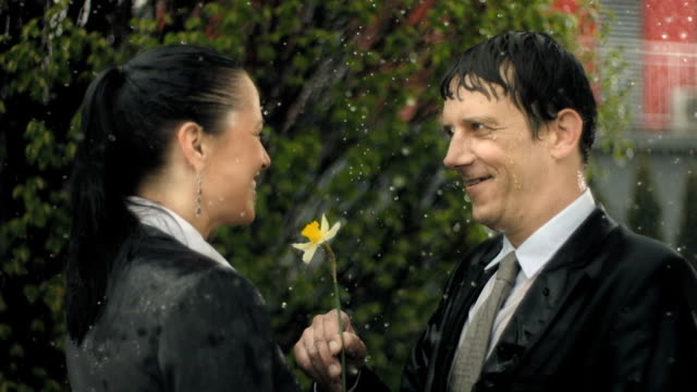 HD Super Slow-Mo: Loving Business Couple In The Rain