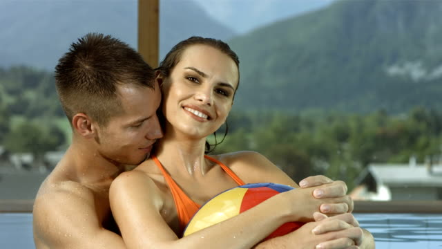 HD Super Slow-Mo: Loving Couple In The Pool