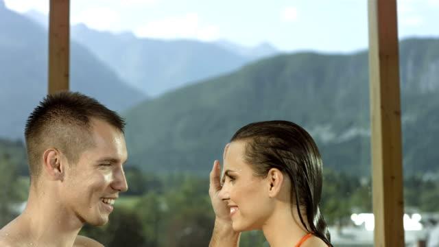 hd 超スローモーション: loving 男性彼女の顔に触れ - adults only videos点の映像素材/bロール