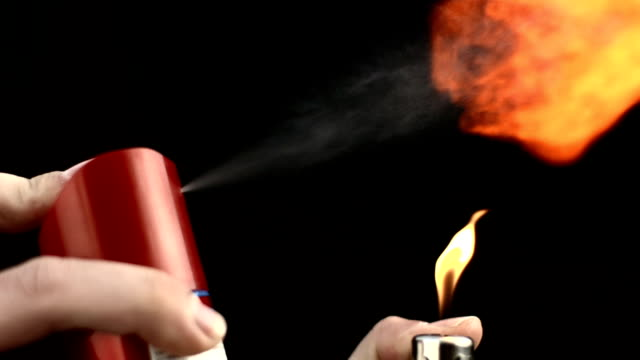hd super slow-mo: making fire with household aerosol can - aerosol can stock videos & royalty-free footage