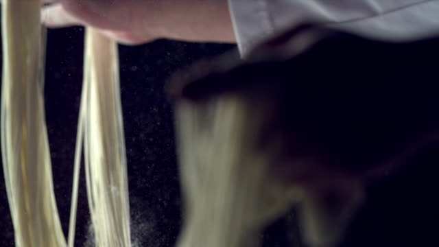hd super slow-mo: making noodles - peasant bread stock videos and b-roll footage
