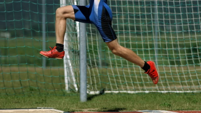 hd super slow-mo: male athlete training a long jump - long jump stock videos & royalty-free footage