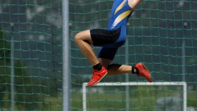 hd super slow-mo: man doing a hitch-kick long jump - long jump stock videos & royalty-free footage