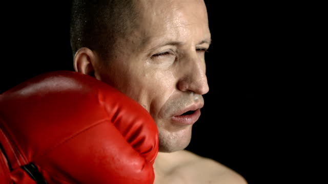 hd super slow-mo: man get punched in the face - boxing stock videos & royalty-free footage